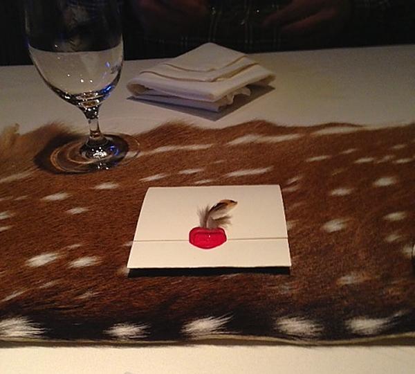 Next envelope on table with deer runner