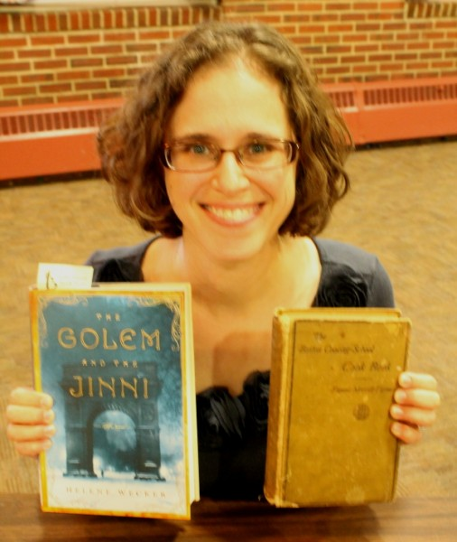 Wecker holding both books