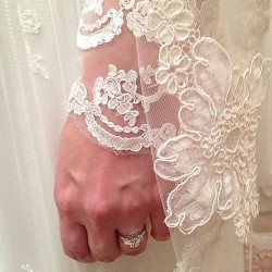 Kara wedding photo of ring and dress sleeve