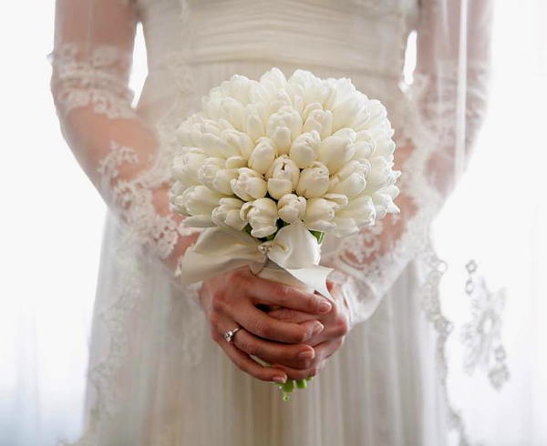 Kara wedding showing top of dress and bouquet