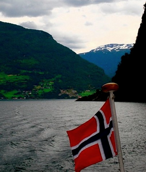 Norway on fijords with flag