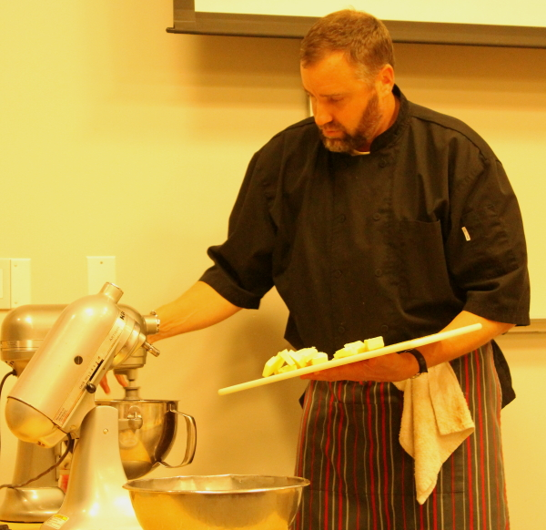Yule log chef adding butter