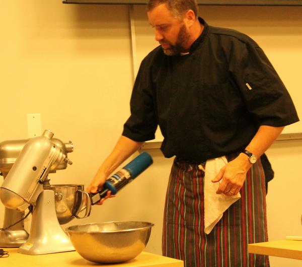 Yule log chef blow torching bowl