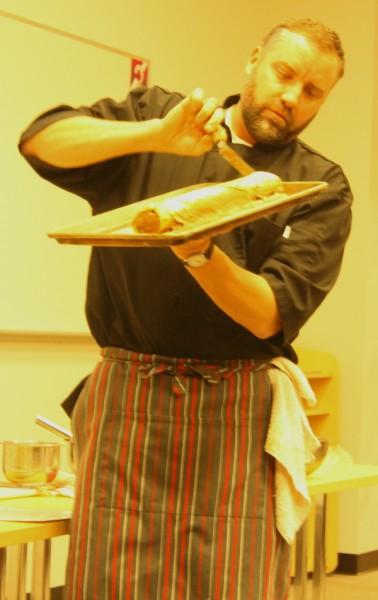 Yule log chef frosting log