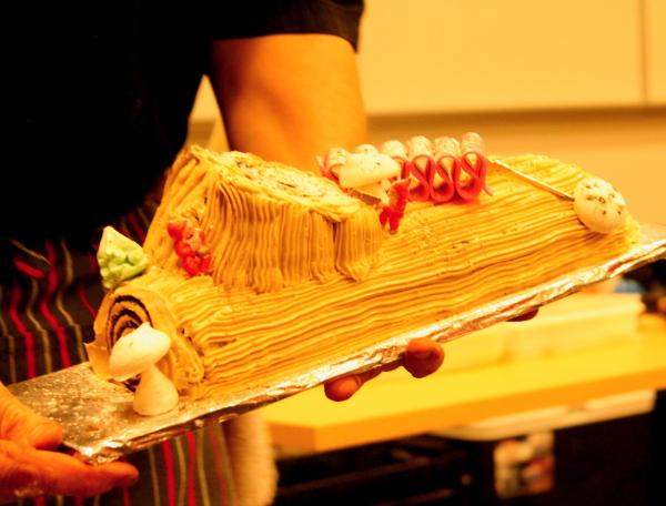 Yule log chef holding finished product up close