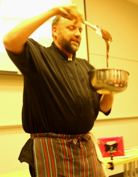 Yule log chef showing chocolate in bowl
