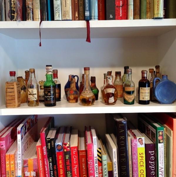 Omnivore book shelf with liquor bottles