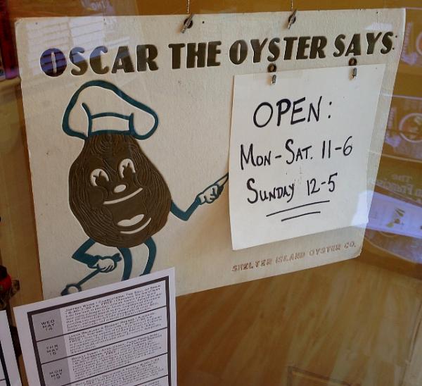 Omnivore open hours sign