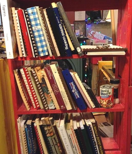 Wedding Kitchen Witch cookbooks on shelf