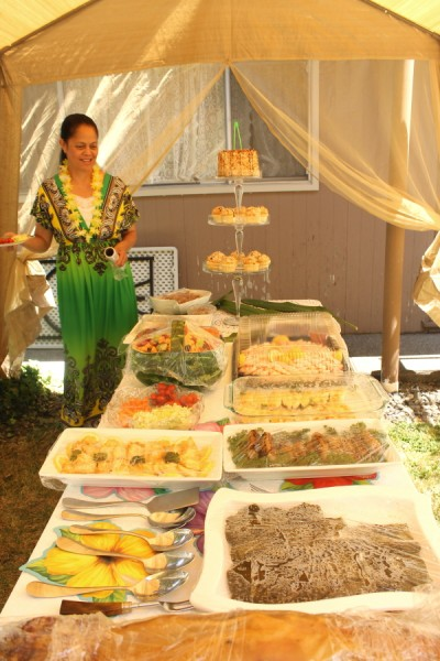 Tonga Malia with food table