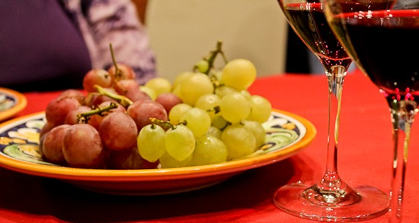 Butera grapes and wine on table
