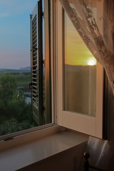 Butera sunset with curtain