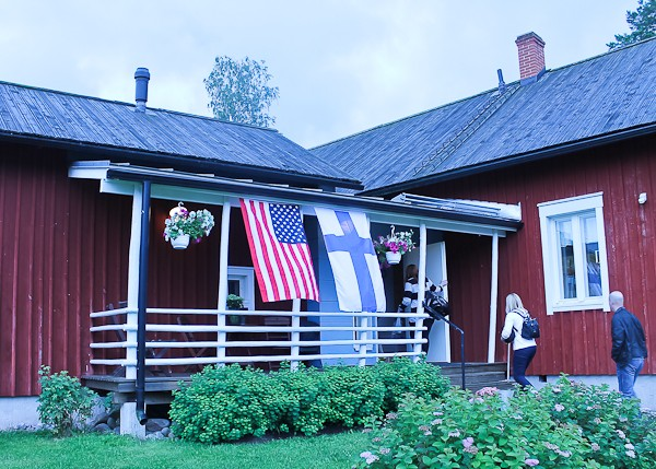 Farmhouse entry with flags