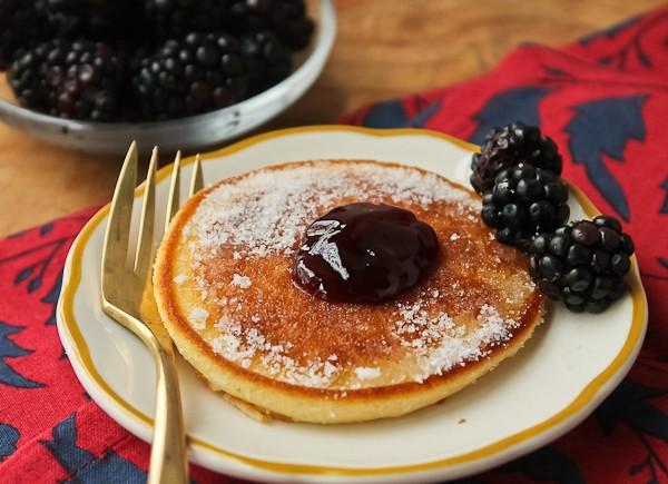 Scottish pancake with bowl of blackberries_